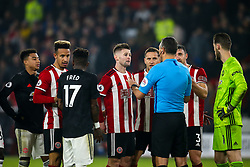 Sheffield United and Manchester United argue with Referee Andre Marriner as Oliver McBurnie of Sheffield United's goal is reviewed by VAR - Mandatory by-line: Robbie Stephenson/JMP - 24/11/2019 - FOOTBALL - Bramall Lane - Sheffield, England - Sheffield United v Manchester United - Premier League