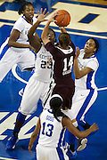 UK forward/center Samarie Walker, center, contests a shot by Mississippi State guard Kendra Grant in the first half. The University of Kentucky Women hosted Mississippi State University Thursday, Jan. 17, 2013 at Memorial Coliseum in Lexington. Photo by Jonathan Palmer