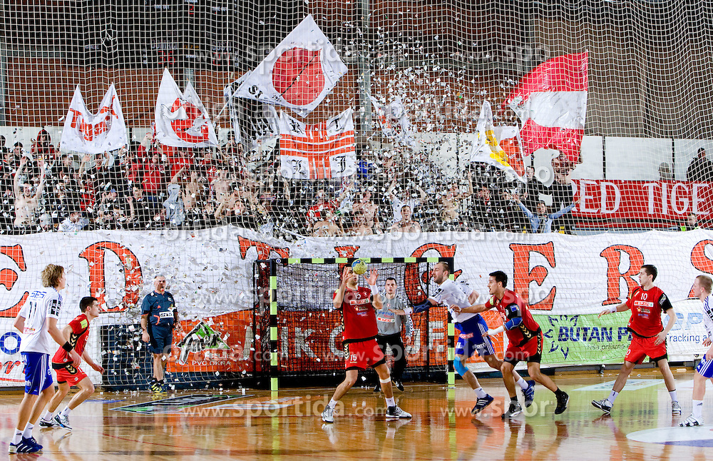 Janko Bozovic of Slovan (15) and Red Tigers, fans of Slovan during the 1/ 8 Men's European Handball Challenge Cup match between RD Slovan, Slovenia and Ystads IF, Sweden, on February 21, 2009 in Arena Kodeljevo, Ljubljana, Slovenia. Slovan defeated Ystads 37-27 and qualified to quarterfinals. (Photo by Vid Ponikvar / Sportida)