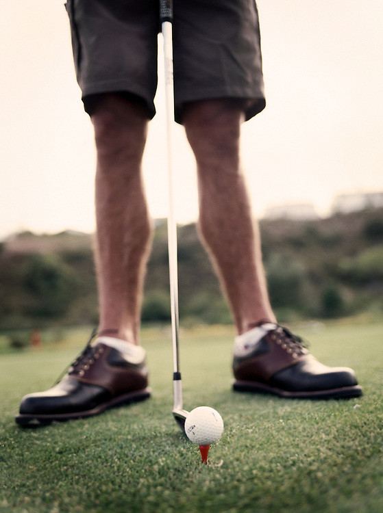 Golfer prepares to tee off on golf course