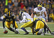 October 10, 2009: Iowa defensive tackle Adrian Clayborn (94) tries to grab a fumble by Michigan quarterback Tate Forcier (5) during the first half of the Iowa Hawkeyes' 30-28 win over the Michigan Wolverine's at Kinnick Stadium in Iowa City, Iowa on October 10, 2009.
