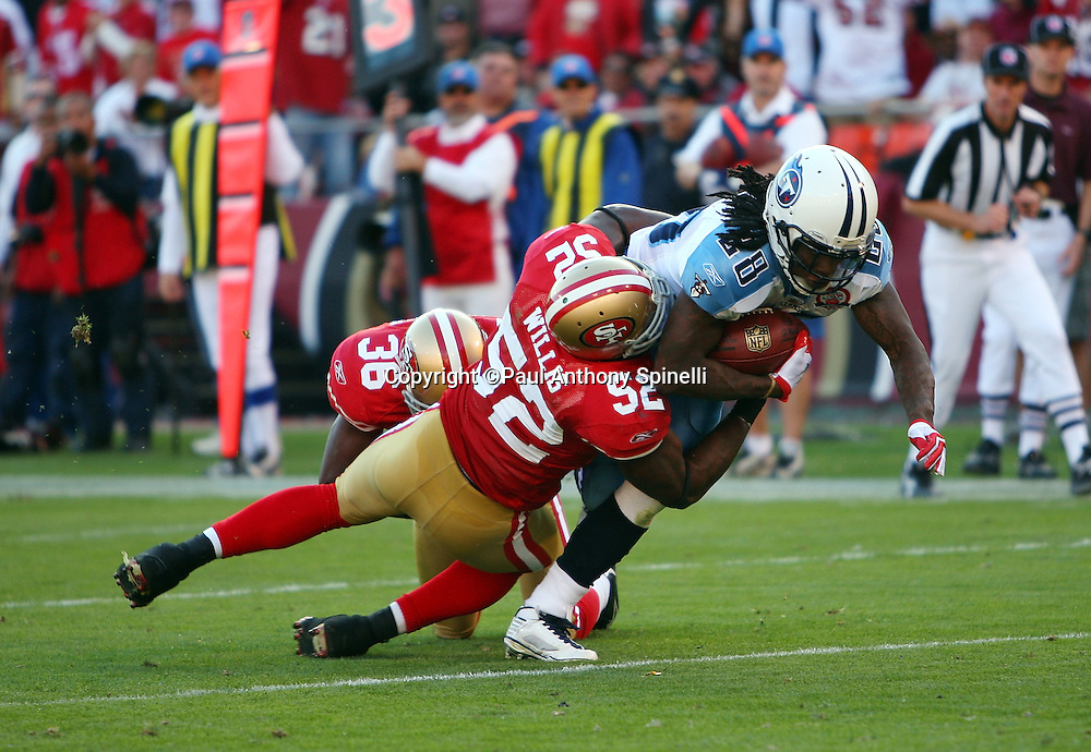 Tennessee Titans running back Chris Johnson (28) gets tackled by diving San Francisco 49ers linebacker Patrick Willis (52) after catching a pass good for 16 yards and first and goal during the NFL football game against the San Francisco 49ers, November 8, 2009 in San Francisco, California. The Titans won the game 34-27. (©Paul Anthony Spinelli)