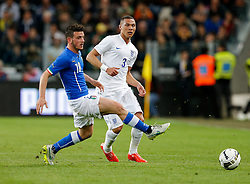 Kieran Gibbs of England is challenged by Alessandro Florenzi of Italy - Photo mandatory by-line: Rogan Thomson/JMP - 07966 386802 - 31/03/2015 - SPORT - FOOTBALL - Turin, Italy - Juventus Stadium - Italy v England - FIFA International Friendly Match.