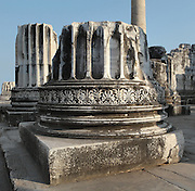 Carved decorative column base at the Temple of Apollo, 4th century BC, Didyma, Aydin, Turkey. Didyma was an ancient Greek sanctuary on the coast of Ionia near Miletus, consisting of a temple complex and the oracle of Apollo, or Didymaion, who was visited by pilgrims from across the Greek world. The earliest temple ruins found here date to the 8th century BC but Didyma's heyday lasted throughout the Hellenistic age. It was approached along a 17km Sacred Way from Miletus and is the largest sanctuary in Western Turkey. Picture by Manuel Cohen