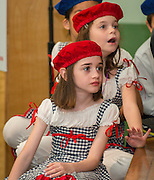 French students participate in the celebration of Claire Frazier being awarded the Chevalier dans Ordre des Palmes Academiques by France Cultural Attache Sylvie Christophe at Kolter Elementary School, November 20, 2013.