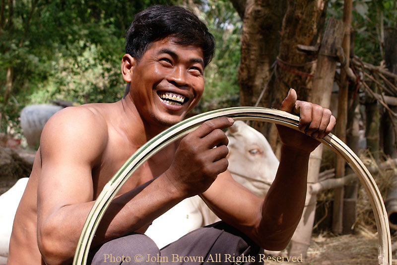 A farmer begins production of a basket that will be used for carrying tobacco leaves in Ban Russei, Kampong Cham Province, Cambodia. It will take him three days to construct the basket. Kampong Cham Province is well known for it's tobacco production and is home to The British-American Tobacco Company of Australia.