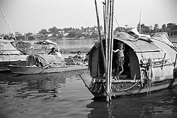 BANGLADESH DHAKA JUL94 - A child living on a boat on the Buriganga River near Dhaka poses for a photo. There are numerous communities of gipsies and boat people living on the shores of the Buriganga River...jre/Photo by Jiri Rezac..© Jiri Rezac 1994
