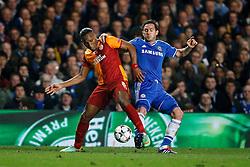 Galatasaray Forward Didier Drogba (CIV) is challenged by Chelsea Midfielder Frank Lampard (ENG) - Photo mandatory by-line: Rogan Thomson/JMP - 18/03/2014 - SPORT - FOOTBALL - Stamford Bridge, London - Chelsea v Galatasaray - UEFA Champions League Round of 16 Second leg.