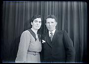 50+ adult couple studio portrait circa 1930s