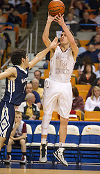 Wheeling Central guard Chase Harler (14) shoots a jumper against Magnolia during the Class A championship game at the Charleston Civic Center.