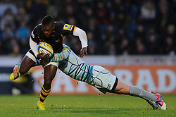 Wasps Winger (#11) Christian Wade is tackled by Leicester Inside Centre (#12) Dan Bowden during the second half of the match - Photo mandatory by-line: Rogan Thomson/JMP - Tel: Mobile: 07966 386802 25/11/2012 - SPORT - RUGBY - Adams Park - High Wycombe. London Wasps v Leicester Tigers - Aviva Premiership.
