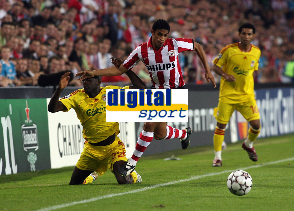 Photo: Chris Ratcliffe.<br /> PSV Eindhoven v Liverpool. UEFA Champions League, Group C. 12/09/2006.<br /> Mohamed Sissoko of Liverpool clashes with Michael Reiziger of PSV Eindhoven.