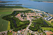 Nederland, Noord-Brabant, Willemstad, 12-06-2009; Vestingstad aan het Hollandsch Diep, beschermd stadsgezicht (inclusief verdedigingswallen en het vrije schootsveld). In de achtergrond het Haringvliet en de Haringvlietbrug. .Fortified city on the Hollands Diep, protected town (including defensive walls); in the background Haringvliet and Haringvliet Bridge; fortress, tourism, marina, walls, monument, cultural heritage Swart collectie, luchtfoto (25 procent toeslag); Swart Collection, aerial view / aerial photo (additional fee required).Swart collectie, luchtfoto (25 procent toeslag); Swart Collection, aerial photo (additional fee required).foto Siebe Swart / photo Siebe Swart