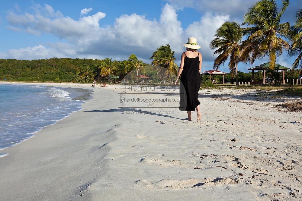 An woman walks along Red Beach (Playa Caracas) on Vieques Island, Puerto Rico.