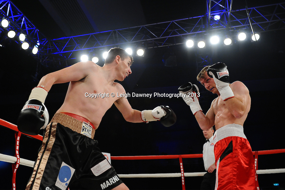 Peter McDonagh (black shorts) defeats Arek Malek in a Welterweight contest. Glow, Bluewater, Kent, UK. Hennessy Sports. 16.11.13 © Leigh Dawney Photography 2013.