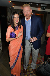 FATIMA BHUTTO and BORIS BECKER at a reception to celebrate the publication of The Shadow of The Crescent Moon by Fatima Bhutto at the Belgraves Hotel, 20 Chesham Place, London, on 2nd December 2013.
