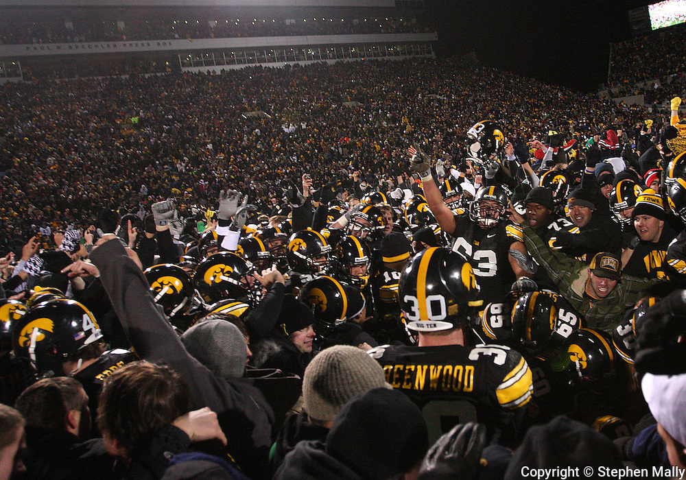 08 NOVEMBER 2008: Iowa players and fans celebrate in the middle of the field after an NCAA college football game against Penn State, at Kinnick Stadium in Iowa City, Iowa on Saturday Nov. 8, 2008. Iowa beat Penn State 24-23.