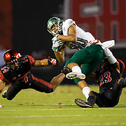 22 September 2018: San Diego State Aztecs safety Tariq Thompson (14) and cornerback Darren Hall (23) bring down Eastern Michigan Eagles wide receiver Dylan Drummond (80) after a reception in the second quarter. The San Diego State Aztecs beat the Eastern Michigan Eagles 23-20 in over time at SDCCU Stadium in San Diego, California.