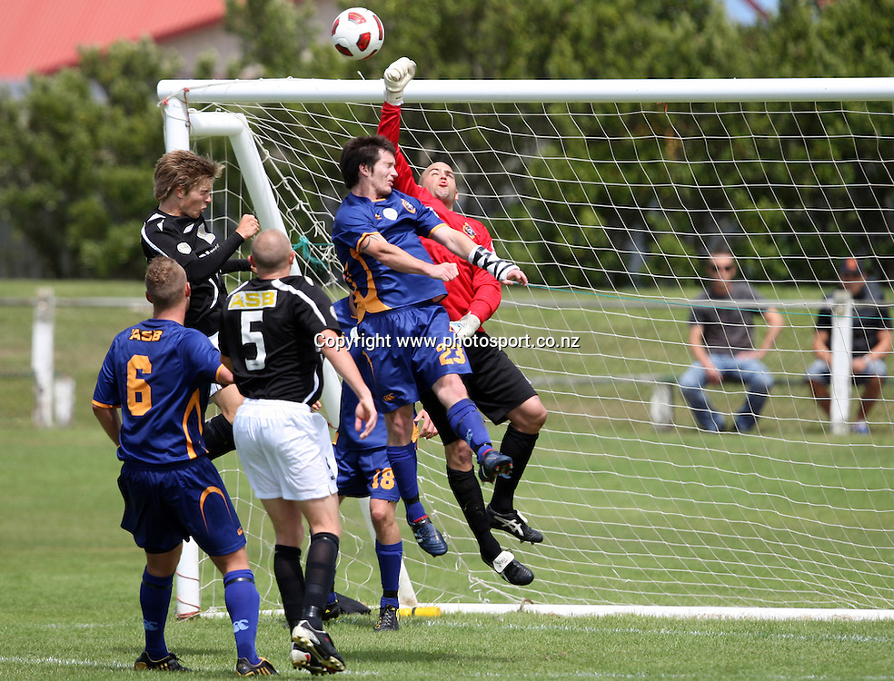 Otago United goal keeper Adam Highfield climbs high to punch the ball away.<br /> ASB Premiership Football - Otago United v Hawke's Bay United, 23 January 2011, Tahuna Park, Dunedin, New Zealand.<br /> Photo: Rob Jefferies / www.photosport.co.nz