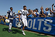 Jul 29, 2018; Costa Mesa, CA, USA; Los Angeles Chargers cornerback Marcus Edmond (24) and running back Austin Ekeler (30) are greeted by fans during training camp at Jack R. Hammett Sports Complex.