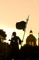 Statue in the Plaza Fundadores with the Metropolitan Cathedral (Catedral Metropolitana) in the background, in the historic Center of Guadalajara, Jalisco, Mexico
