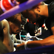 Wytana Faulk fights with Christen Brightwell during the Mad Integrity Fight sports boxing match at the Florida Orange Event Center in Lakeland, Florida on Saturday October 10, 2015. Photo: Alex Menendez
