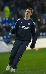 CARDIFF, WALES - Tuesday, February 1, 2011: Cardiff City's Aaron Ramsey warms up before the Football League Championship match against Reading at the Cardiff City Stadium. (Photo by Gareth Davies/Propaganda)