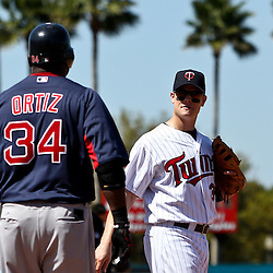 March 11, 2011; Fort Myers, FL, USA; Boston Red Sox first baseman David Ortiz (34) and Minnesota Twins first baseman Justin Morneau (33) talk during a spring training exhibition game at Hammond Stadium.   Mandatory Credit: Derick E. Hingle