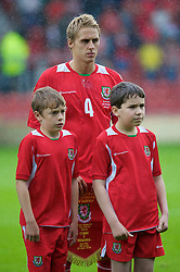 WREXHAM, WALES - Wednesday, August 20, 2008: Wales' captain David Edwards and mascots before the UEFA Under 21 European Championship Qualifying Group 10 match against Romania at the Racecourse Ground. (Photo by David Tickle/Propaganda)