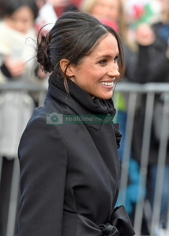 Meghan Markle smiles during a walkabout with Prince Harry at Cardiff Castle in Wales on January 18, 2018
