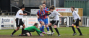 Sam Saint getting her hand across to stop the attack during the FA Women's Premier League match between Crystal Palace LFC and Bedford Ladies at Bromley Football Club, Bromley, Kent, United Kingdom on 15 March 2015. Photo by Michael Hulf.