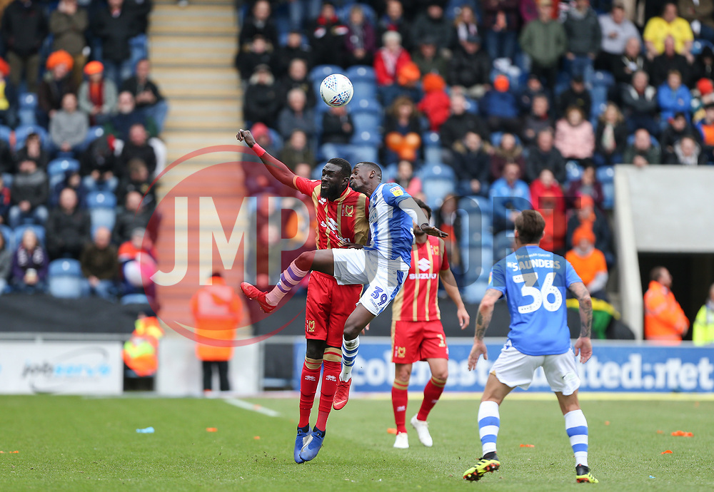 Abo Eisa of Colchester United and Ousseynou Cisse of Milton Keynes Dons challenge for a header - Mandatory by-line: Arron Gent/JMP - 27/04/2019 - FOOTBALL - JobServe Community Stadium - Colchester, England - Colchester United v Milton Keynes Dons - Sky Bet League Two