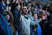Leeds United fan sings during the The FA Cup fourth round match between Bolton Wanderers and Leeds United at the Macron Stadium, Bolton, England on 30 January 2016. Photo by Simon Brady.