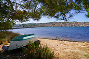 A deserted rowing boat on land Photographed on the Greek Island of Cephalonia, Ionian Sea, Greece