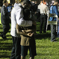 A man and his son react to the not guilty verdict in the George Zimmerman murder trial at the Seminole County Courthouse on Saturday, July 13, 2013, in Sanford, Florida.  Zimmerman had been charged for the 2012 shooting death of Trayvon Martin and was found not guilty by a jury of six women. The protests on the grounds ended peacefully after the verdict was read. (AP Photo/Alex Menendez)