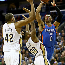Feb 25, 2016; New Orleans, LA, USA; Oklahoma City Thunder guard Russell Westbrook (0) shoots over New Orleans Pelicans guard Norris Cole (30) and center Alexis Ajinca (42) during the second quarter of a game at Smoothie King Center. Mandatory Credit: Derick E. Hingle-USA TODAY Sports