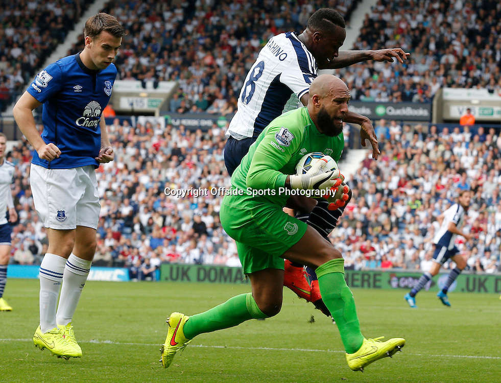 13th September 2014 - Barclays Premier League - West Bromwich Albion v Everton - Tim Howard of Everton shouts as he is fouled by Saido Berahino of West Bromwich Albion - Photo: Paul Roberts / Offside.