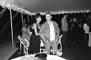 Ian Schrager and Rita. H.B.O. party. East Hampton. 1993. © Copyright Photograph by Dafydd Jones 66 Stockwell Park Rd. London SW9 0DA Tel 020 7733 0108 www.dafjones.com