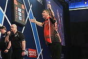 Mensur Suljovic beats Kevin Painter and celebrates during the William Hill PDC World Darts Championship at Alexandra Palace, London, United Kingdom on 18 December 2017. Photo by Shane Healey.