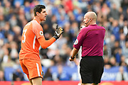 Chelsea goalkeeper Thibaut Courtois (13) talks to referee Lee Mason after fouling Leicester City forward Jamie Vardy (9) during the Premier League match between Leicester City and Chelsea at the King Power Stadium, Leicester, England on 9 September 2017. Photo by Jon Hobley.
