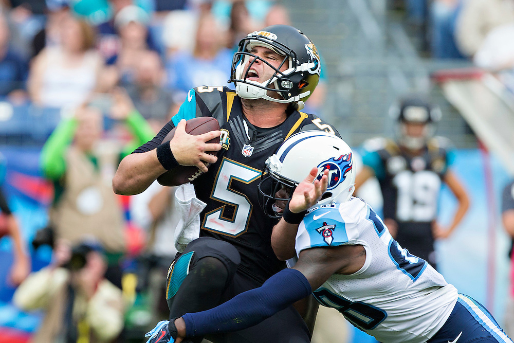 NASHVILLE, TN - OCTOBER 12:  Blake Bortles #5 of the Jacksonville Jaguars is tackled by Marqueston Huff #28 of the Tennessee Titans at LP Field on October 12, 2014 in Nashville, Tennessee.  The Titans defeated the Jaguars 16-14.  (Photo by Wesley Hitt/Getty Images) *** Local Caption *** Blake Bortles; Marqueston Huff