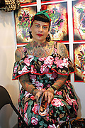 Portugese tattoo artist sitting by her stall at the 2nd International Tattoo Convention in London on Saturday, Oct. 7, 2006, in London, UK. With over 15.000 visitors in three days during the 2005 edition, the event placed London in a central position in the tattoo world.  This year about 150 artists ,representing all the tattoo styles, are ticking away with their machines in a very exciting atmosphere. **ITALY OUT**....