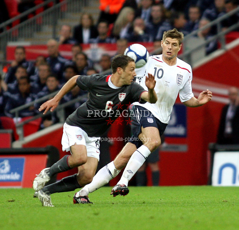 London, England - Wednesday, May 28, 2008: England's Steven Gerrad in action against USA's Heath Pearce at Wembley Stadium. (Pic by Chris Ratcliffe/Propaganda)
