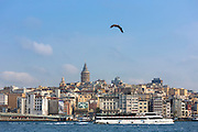 Skyline cityscape of Karakoy, Galata Tower and Beyoglu with ferry boat on Bosphorus River, Istanbul, Republic of Turkey