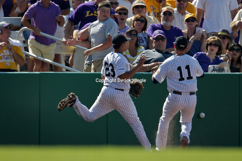 06 June 2009: Rice third baseman Anthony Rendon (23) collides with Rick Hague (11) suffering a leg injury that knocked him out of the game in the top of the second inning, during game two of the NCAA baseball Super Regional between the Rice Owls and the LSU Tigers at Alex Box Stadium in Baton Rouge, Louisiana.
