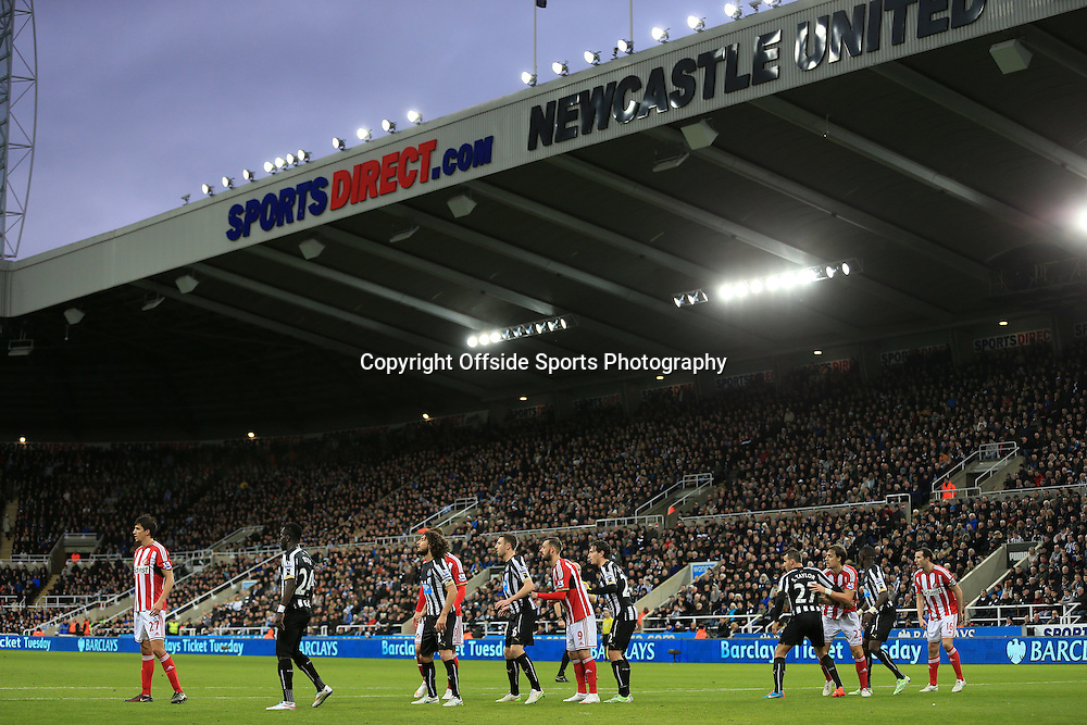 21st December 2014 - Barclays Premier League - Newcastle United v Sunderland - Players form a defensive line at St. James' Park - Photo: Simon Stacpoole / Offside.