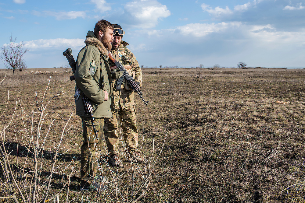 Alex, left, a drill sergeant, and another member of the Azov Brigade attend weapons training at one of the group's training grounds on Saturday, March 7, 2015 in Kulykivske, Ukraine. Photo by Brendan Hoffman, Freelance