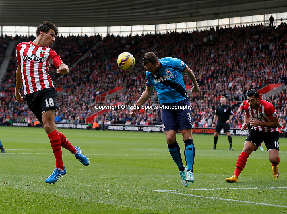 25th October 2014 - Barclays Premier League - Southampton v Stoke City - Erik Pieters of Stoke City heads away as Jack Cork of Southampton tries to flick on - Photo: Paul Roberts / Offside.