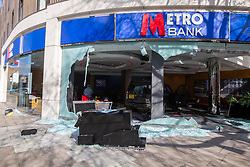 © Licensed to London News Pictures. 16/03/2020. London, UK. An ATM is seen outside a branch of Metro Bank on the Kings Road in Chelsea after a vehicle was reportedly driven into the bank . Photo credit: George Cracknell Wright/LNP