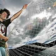 Ian Stewart/Yukon News<br /> Tyler Allec casts a net for Arctic Charr.